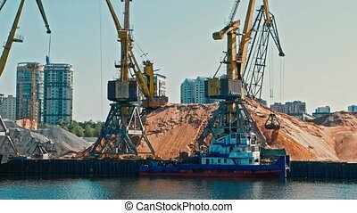 port Cranes Working in Riverport Loading Tracks With Sand View From Moving Boat
