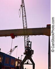 port, grues, coucher soleil