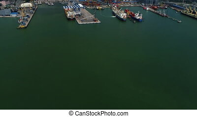 port in black sea. Aerial shot. Flight over harbor. Loading ships in the cargo harbour.