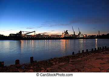 Port in the morning - Sulfur loading on a ship in port of...