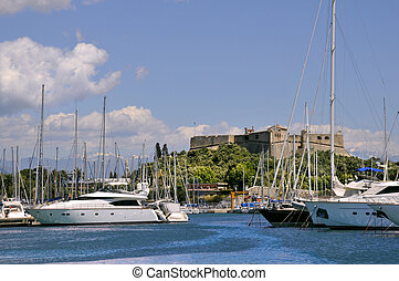 "Port of Antibes on the mediterranean sea in southeastern France with the castle ""fort carr?"" in the background"
