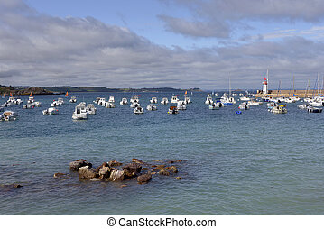 Port of Erquy in France - Port and lighthouse at high tide ...