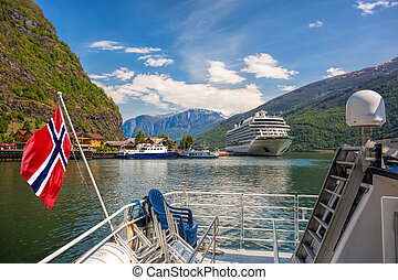 Port of Flam village with ships in fjord, Norway