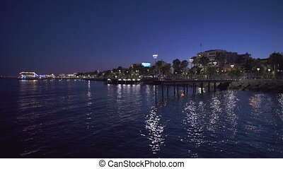 Port of limassol at night time. Reflection of the lights