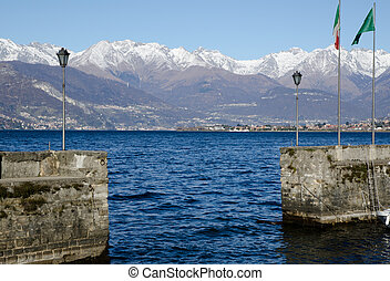 Port on a lake with snow-capped mountains