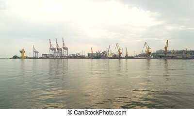 Port with cranes, daytime. Industrial equipment on sky...