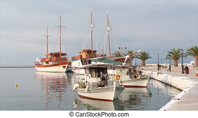 port with fishing boat and sailboat