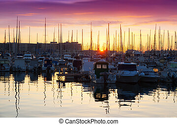 Port with yachts in sunrise. Alicante, Spain