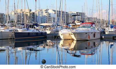 Port yachts sunset water - Evening marina port. Yachts and...