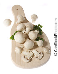 Portabello mushrooms - Edible mushrooms on wooden chopping...