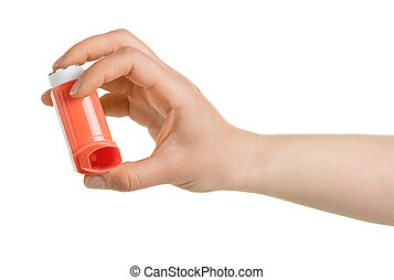 Portable inhaler in female hand isolated on white