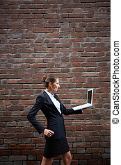 Portable internet - Image of elegant businesswoman with...