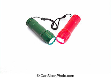 Portable LED flashlights red and green color isolate on a white background. Close-up.