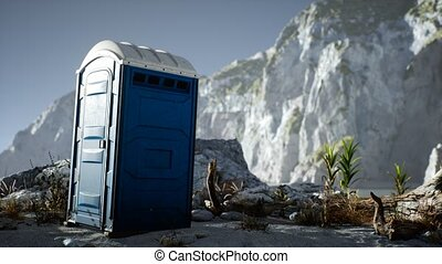 Portable mobile toilet in the beach. chemical WC cabin