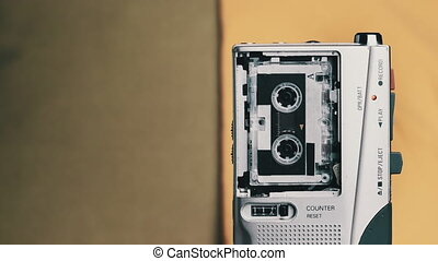 Portable Retro Tape Recorder with Micro Cassette Rec Sound on Yellow Background