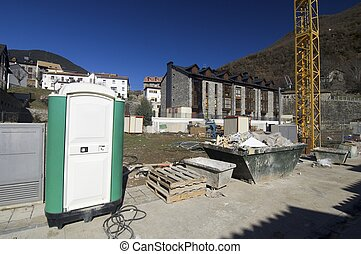 portable toilet at a construction site
