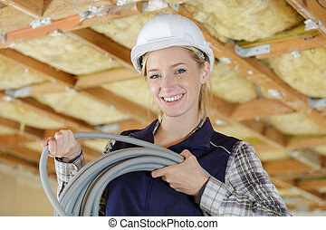 portait of a happy female electrician