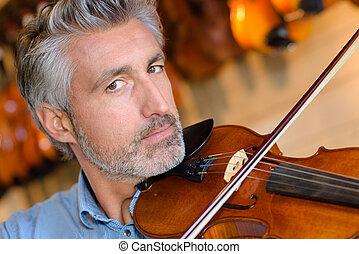 portait of man playing violin