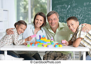 Portait of Parents and children playing at home