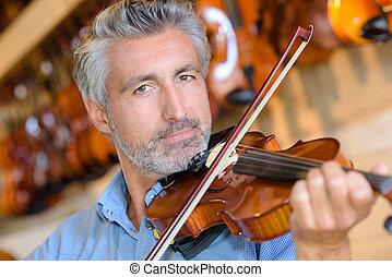 portait of senior man playing violin
