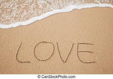 the inscriptions of love on sand beach