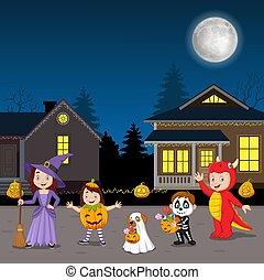 porter, fête, gosses, heureux, costumes, halloween