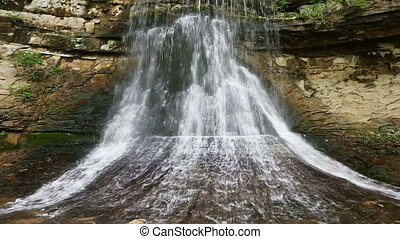 Porter Falls Loop - Loop features water emerging from...