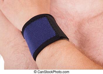 Porter, haut, poignet, fin, attache, homme