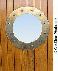 Porthole brass - Ships brass port on wooden door...