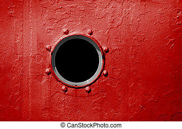 Porthole on red wall of old ship - Porthole on the red wall ...