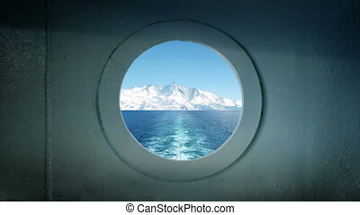 Porthole View Traveling In Arctic Ocean - View from ship's...