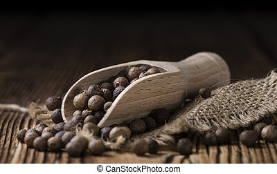 Allspice - Portion of Allspice (detailed close-up shot) on...