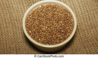 Portion of buckwheat while rotating, close-up.Full hd...