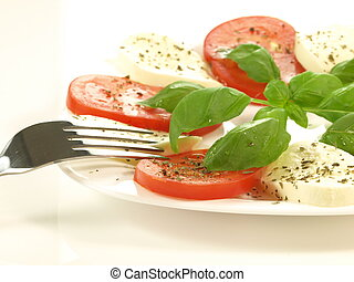 Portion of caprese, closeup, isolated - Caprese salad with ...