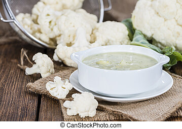 Cauliflower Soup - Portion of Cauliflower Soup (on rustic...