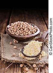 Chick Pea flour (close-up shot) on vintage wooden background