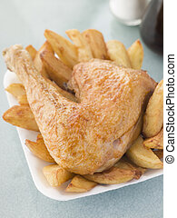 Portion Of Chicken And Chips On A Polystyrene Tray
