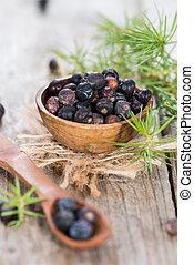 Portion of dried Juniper Berries (close-up shot)