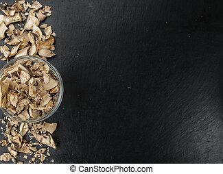Portion of Dried Mushrooms on a slate slab - Dried Mushrooms...