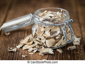 Portion of Dried Mushrooms on wooden background, selective...