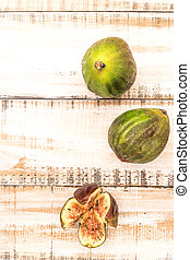 Portion of fresh figs on vintage wooden background