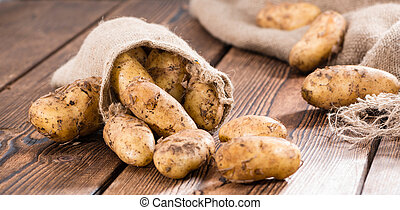 Potatoes - Portion of fresh Potatoes on vintage background