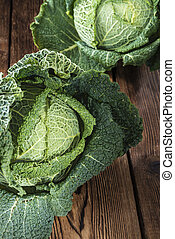 Portion of fresh Savoy (close-up shot) on wooden background