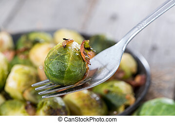 Portion of fried Brussel Sprouts with Ham and Onions