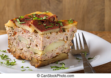 Portion of layered moussaka with parsley