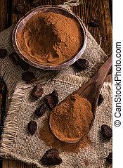 Portion of milled Cola Nut (close-up shot) on wooden...
