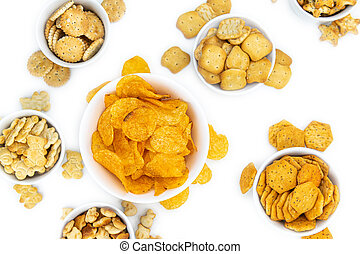 Portion of mixed Snacks isolated on white (close up shot; selective focus)