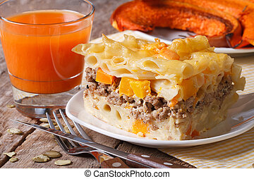 Portion of pasta baked with meat, cheese and pumpkin