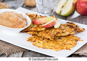 Portion of Potato Fritters on vintage grey wooden background