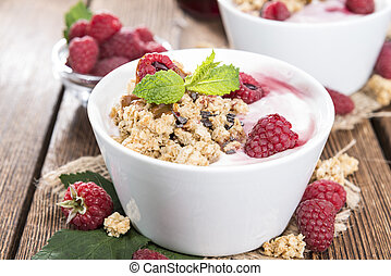 Portion of Raspberry Yogurt with fresh fruits on wooden background